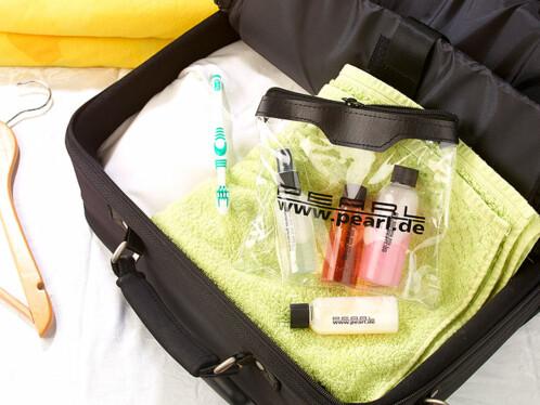 Trousse de voyage avec 4 flacons à remplir