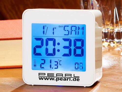 Réveil digital radio piloté avec calendrier et thermomètre intégré