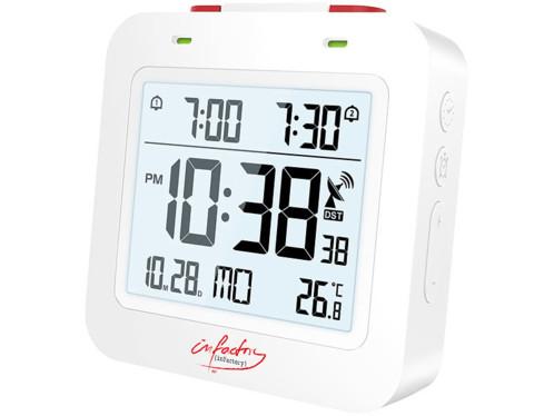 Radio-réveil numérique de couleur blanche.