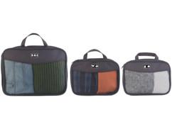 Trois sacs à vêtements compressibles.