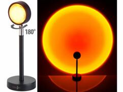 """Lampe à projection à effet """"coucher de soleil"""" avec tête pivotante sur 180°."""