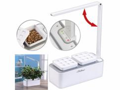 Mini potager avec bac de culture, lampe de croissance à LED et réservoir pour arrosage.